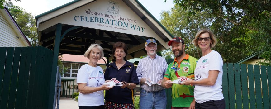 Buderim-Foundations-Roz-Bull-left-and-Keryn-Buderim-Rotarys-Lyn-Phillips-Buderim-Lions-Brian-McBride-presented-back-to-school-vouchers-to-Buderim-Mountain-State-Schools-Chappy-Dave-for-distribution