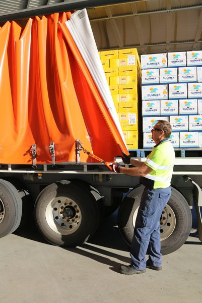 Matthew Muller from BevChain using a Strong Arm Strap to close a tautliner curtain.