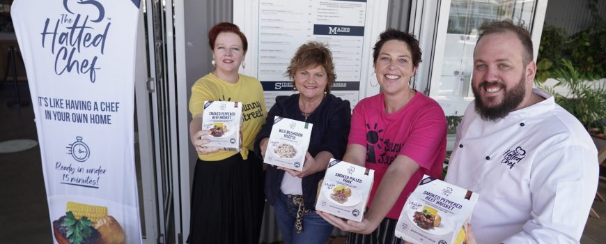 Sunny Street nurse Sonia Goodwin, White's IGA's Roz White, Sunny Street Dr Nova Evans with The Hatted Chef Chris Sell, outside The Dock Mooloolaba, where the product was developed during the COVID shutdown