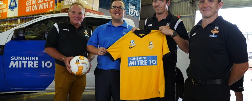 Sunshine-Coast-Wanderers-vice-president-Ian-Grant-Sunshine-Mitre-10s-Nick-Brind-left-and-coach-Paul-Arnison-right-present-2020-jersey-to-Senior-Mens-Captain-Jeremy-Stewart