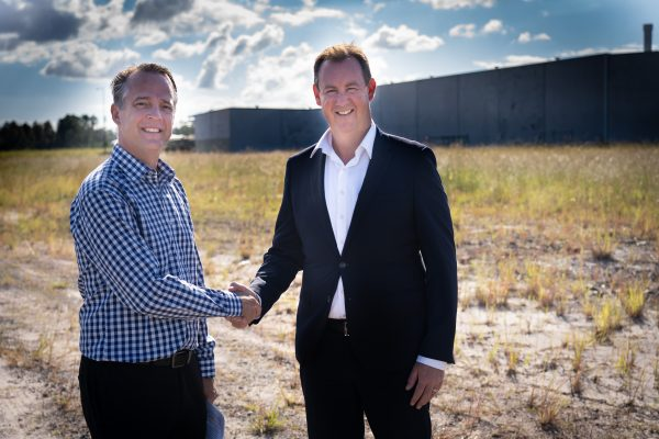 Sunshine Mitre 10 general manager Neil Hutchins with Stockland Senior Economic Development Manager Matthew Byrne at the Aura Sunshine Mitre 10 site - photo by Reflected Image PR