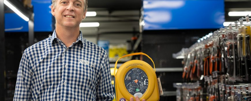 Sunshine Mitre 10 general manager Neil Hutchins with one of the defibrillators, now in every Sunshine Mitre 10 store - hoz